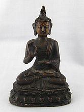A bronze figure of a seated Buddha. Ht.17cm.