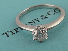 A platinum diamond solitaire ring by Tiffany & Co.