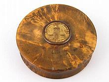 A turned burr walnut box with tortoiseshell lining