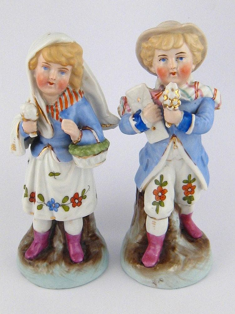 A pair of 19th. c. continental ceramic figures of