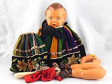 A composition doll with articulated limbs (AF)