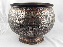 A large 19th. c. footed copper bowl, extensively
