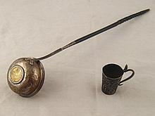 A Georgian silver toddy ladle with whalebone