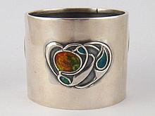 A Liberty &Co.; Arts and Crafts silver napkin ring