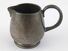 A Liberty's Tudric pewter cream jug, Marks