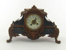 A bronzed metal mounted marble mantel clock, the eight day movement with enamel dial striking on a bell.(pendulum missing.)33x17x23cm. high.