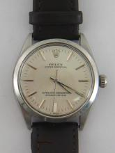 ROLEX, Oyster Perpetual, a gentleman's stainless steel automatic wristwatch, ref. 1002, no.4114071 circa 1974/1975, the silvered dial with applied baton numerals and hands, and centre seconds, the case 34mm diameter, on a brown stitched leather strap