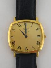 PIAGET, a gentleman's 18 carat gold automatic dress watch, no. 12406/106011, the cushion shaped case with gilt dial, black Roman numerals, and feuille hands, with Piaget automatic movement, the case 33mm wide, on a black leather stitched strap