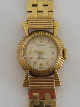 ROLEX, a 1960s lady's 18 carat gold manual wind wristwatch, no. 8793/20, the small signed circular dial with textured dial, and gold feuille numerals and hands, with 17 jewel Rolex movement, the case 18mm diameter, on a block link bracelet, 28.4 gms, in a Rolex box