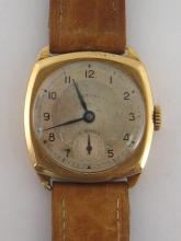 ROTARY, a 1940s 9 carat gold manual wind wristwatch, ref. 11102 no. 107679, the cushion shaped Dennison case with silver polished and matt dial, black Arabic numerals, blued steel feuille hands, with 15 jewel Rotary movement, the case hallmarked Birmingham 1947, 27mm wide, on a tan leather strap