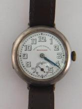 WEST END WATCH Co. 'Keep Sake', a first quarter 20th century silver manual wind wristwatch, no.137075, the circular case with signed dial, Arabic numerals, blued steel feuille hands, and subsidiary seconds dial, with manual wind movement, the case 30mm diameter, on a brown leather strap