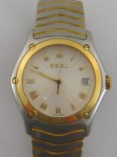 EBEL Wave, a gentleman's stainless steel and 18 carat gold quartz wristwatch, no.1187F41, the circular case with engine turned 'sunburst' dial, applied gold Roman numerals, and baton hands, and date aperture at 3 o'clock, the case 40mm wide, on a integral two tone articulated bracelet