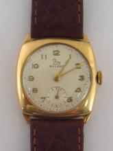 RECORD, a 9 carat gold mid size wristwatch, no. 224909, the cushion shaped case with silvered dial, applied gold Arabic numerals, baton hands and sub seconds dial, with 15 jewel Record movement, the case hallmarked London 1959, 28mm wide, on a brown leather strap