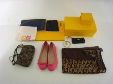 FENDI, a mixed lot comprising a silk scarf, a gilt metal bracelet, a purse, a clutch bag, and a pair of pink ballet pumps (size 39)