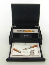 GRAF VON FABER CASTELL, Amber Room Pen of the Year 2004, an amber and rhodium plated limited edition fountain pen, with medium 18 carat gold nib, in its presentation case with original outer packaging and paperwork. The pen celebrates the renowned 'Amber Room' commissioned in 1701 by Prussian King Friedrich I.