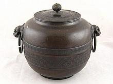 A large Japanese 19th. c. bronze jar and cover