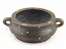A heavy Chinese two handled bronze censer with