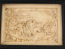 A plaster relief plaque with detailed scene of the