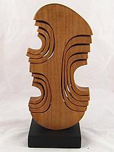 John Spielman. An abstract mahogany sculpture on