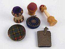 Three Victorian pincushions, a tartan mauchlin ware wheel, a pierced white