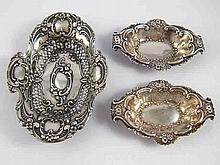 Silver. A pair of embossed bonbon dishes by Nathan and Hayes, Chester 1903,