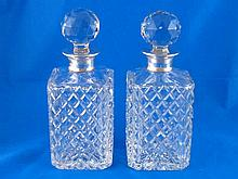 A pair of silver mounted hobnail cut glass square decanters by Mappin and W