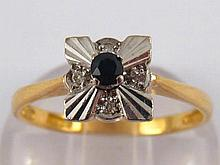 A yellow metal (tests 18 carat gold) sapphire ring, size N, 3.1 gms.