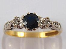 An 18 carat gold sapphire and diamond ring, size Q, 3.5 gms.