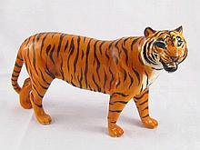 A ceramic model of a tiger by Beswick, marked Beswick, England on two paws.