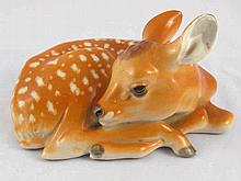 A Russian ceramic model of a fawn, red factory stamp of Lomonosov. Length 2