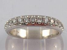 Cartier. A French hallmarked platinum diamond eternity ring by Cartier, sig