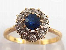 A yellow metal (tests 18 carat gold) sapphire and diamond ring, the sapphir