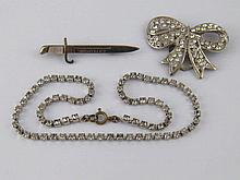 A mixed lot comprising a diamante necklace and two brooches.