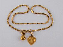A yellow metal (tests 18 carat gold) ankle chain, approx 26cm long, 8.1 gms