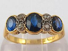 An 18 carat gold sapphire and diamond ring, with platinum settings, largest