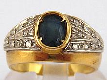 A yellow metal (tests 18 carat gold) sapphire and diamond ring, size N, 4.2