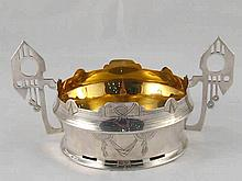 A two handled silver bowl formed and engraved in the Russian Pan Slavic sty