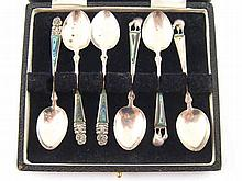 A set of six cased New Zealand silver coffee spoons with abalone shell inse