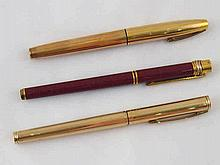 Two fountain pens, a gold plated Sheaffer and a must de Cartier with red la