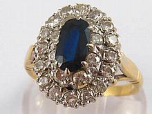 A yellow metal (tests 18 carat gold) sapphire and diamond ring, sapphire ap