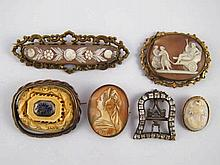 A mixed lot comprising five antique brooches and a buckle.
