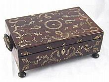 An Indian coromandel lady's sewing box on four turned feet and long bar han