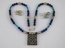 A mixed lot comprising a lapis lazuli and white metal (tests silver) neckla