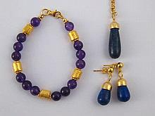 A mixed lot comprising a gilt metal (tests silver) lapis lazuli pendant and