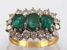 An 18 carat gold emerald and diamond ring, largest emerald approx 6 x 4.5mm