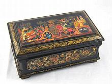 A Russian lacquered jewellery box on four feet , the lid with traditional e