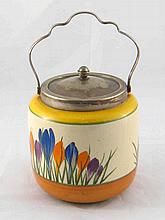 A Clarice Cliff crocus pattern biscuit barrel with Newport Pottery green st