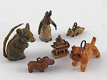 A cold painted bronze Beatrix Potter's Mrs. Rabbit and five other miniature