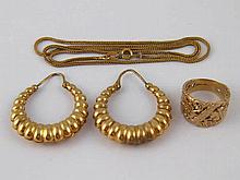 A mixed lot comprising a pair of 9 carat gold hoop earrings (6.9gms), a 9 c
