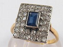 A yellow metal (tests 18 carat gold) sapphire and diamond ring, approx 12 x